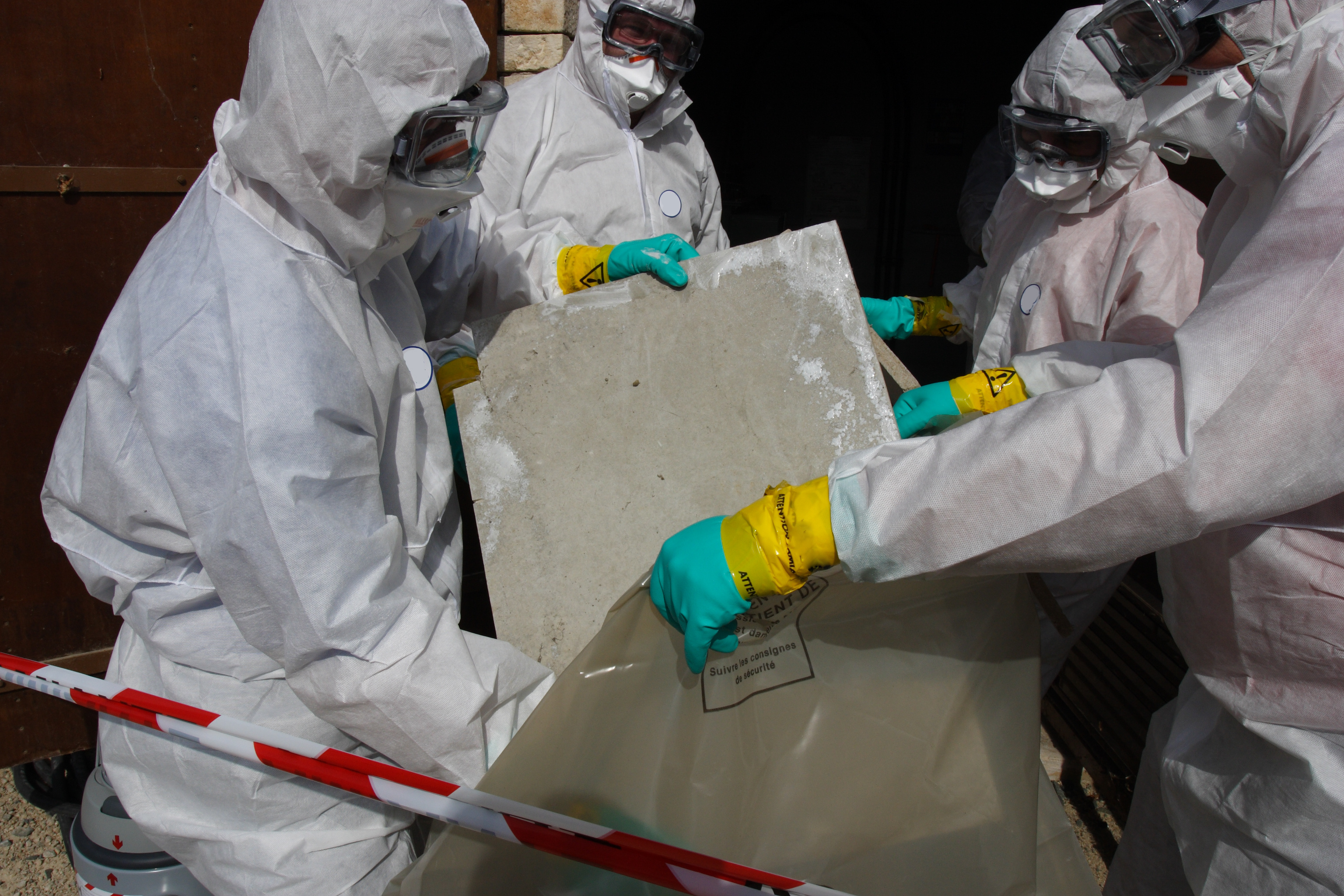 Staff removing some asbestos in a post of transformer