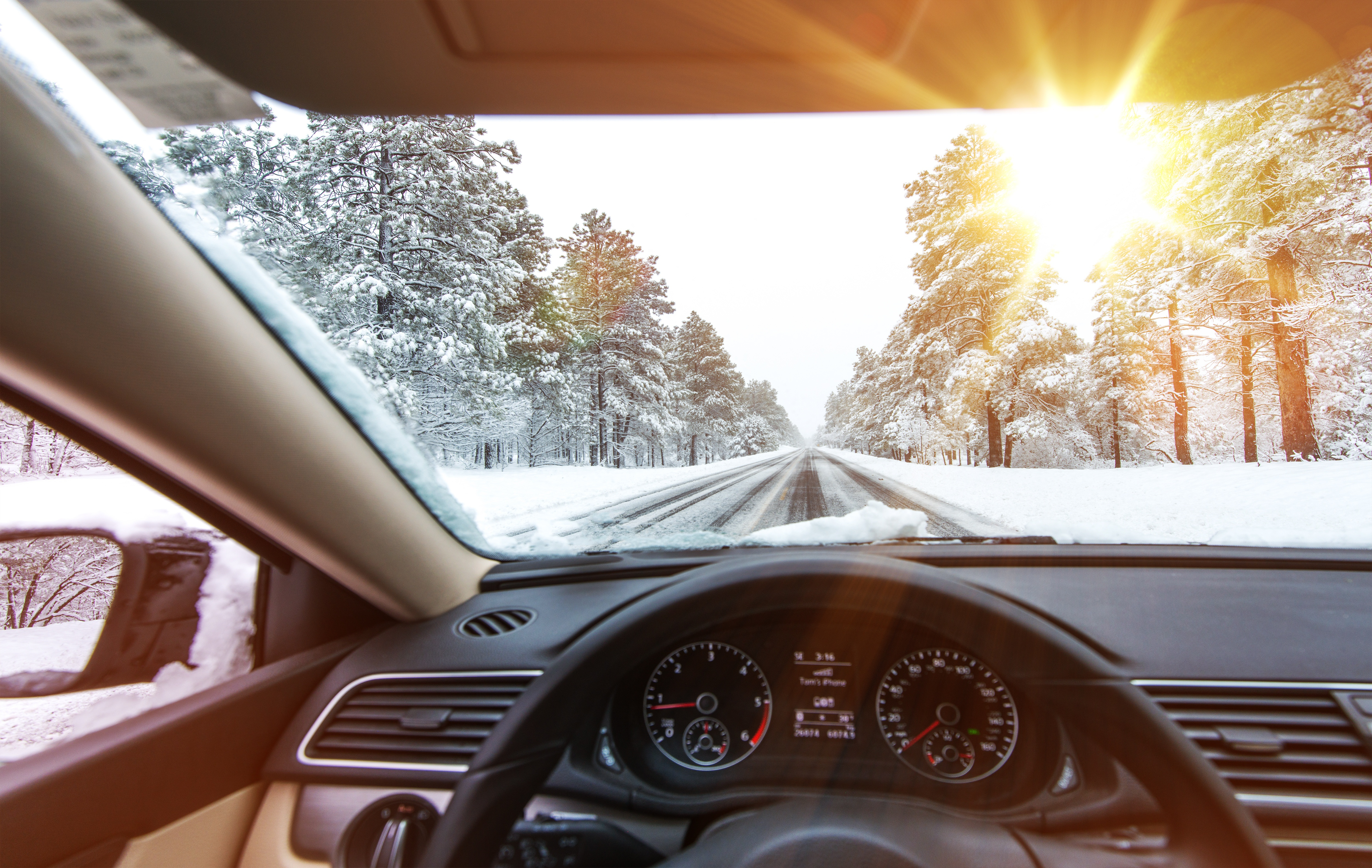 Icy Road Winter Drive. Winter Conditions on the Road with Sunny Sky. Driver View.