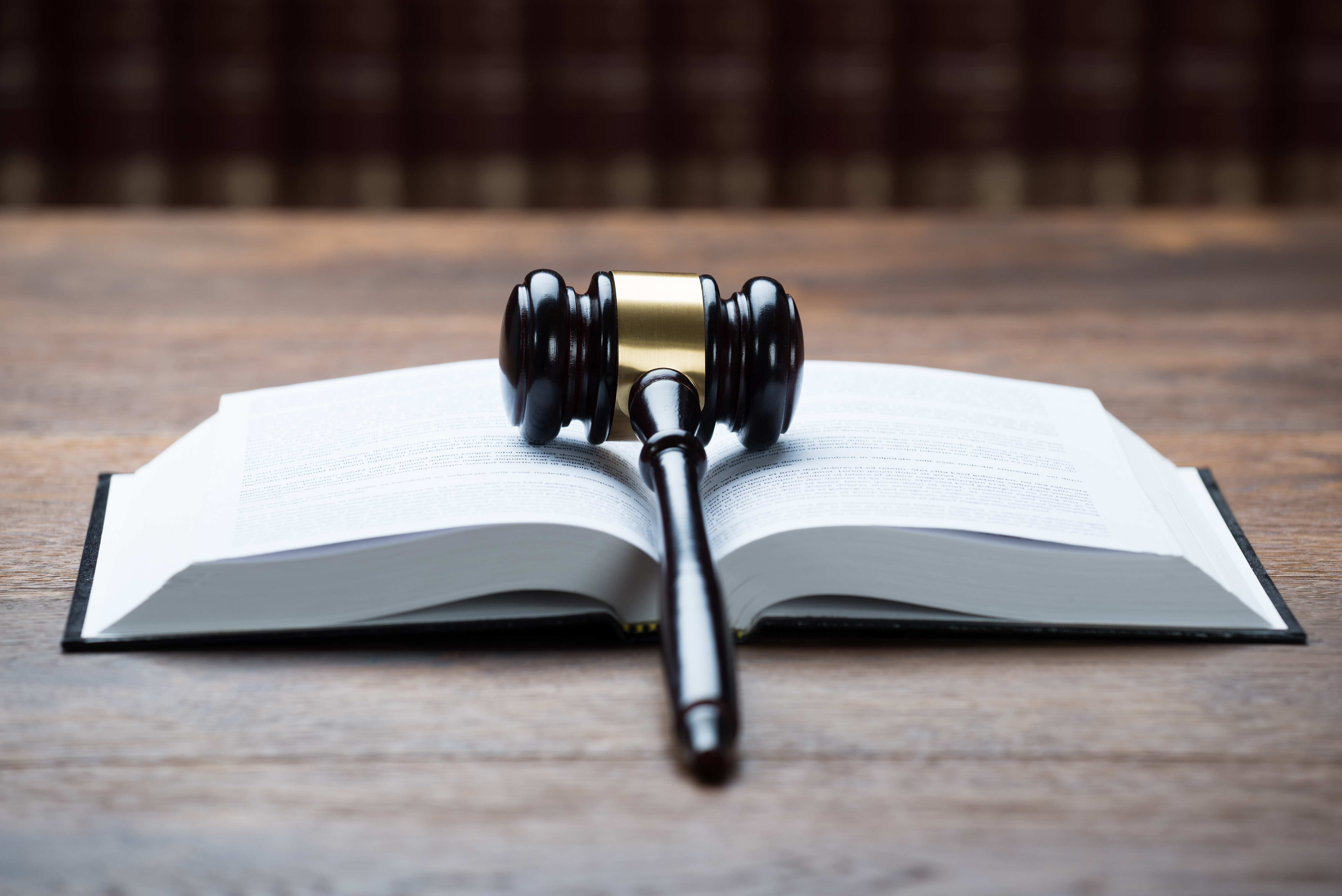 Mallet On Open Legal Book In Courtroom