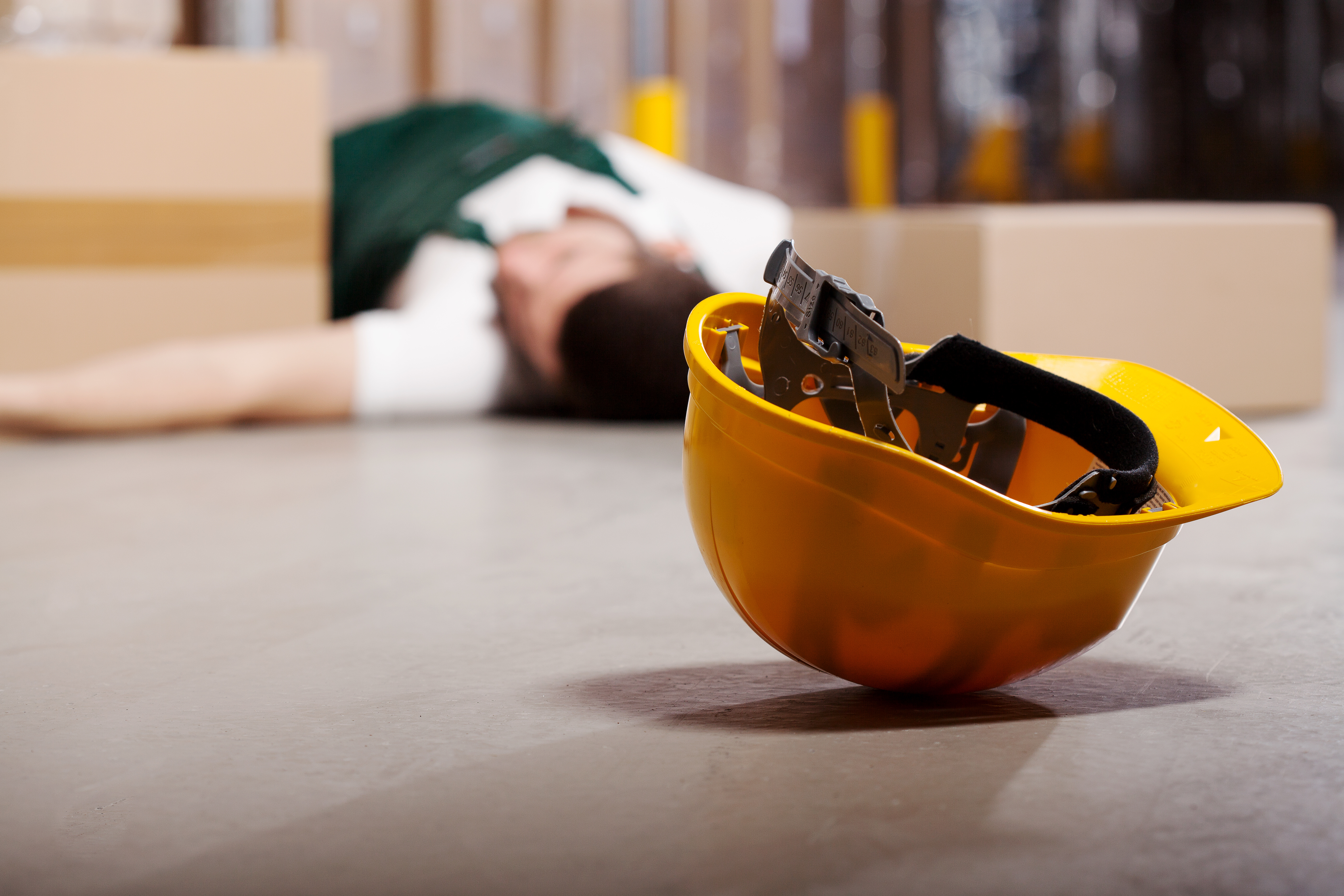 Dangerous accident in warehouse during work - wounded worker
