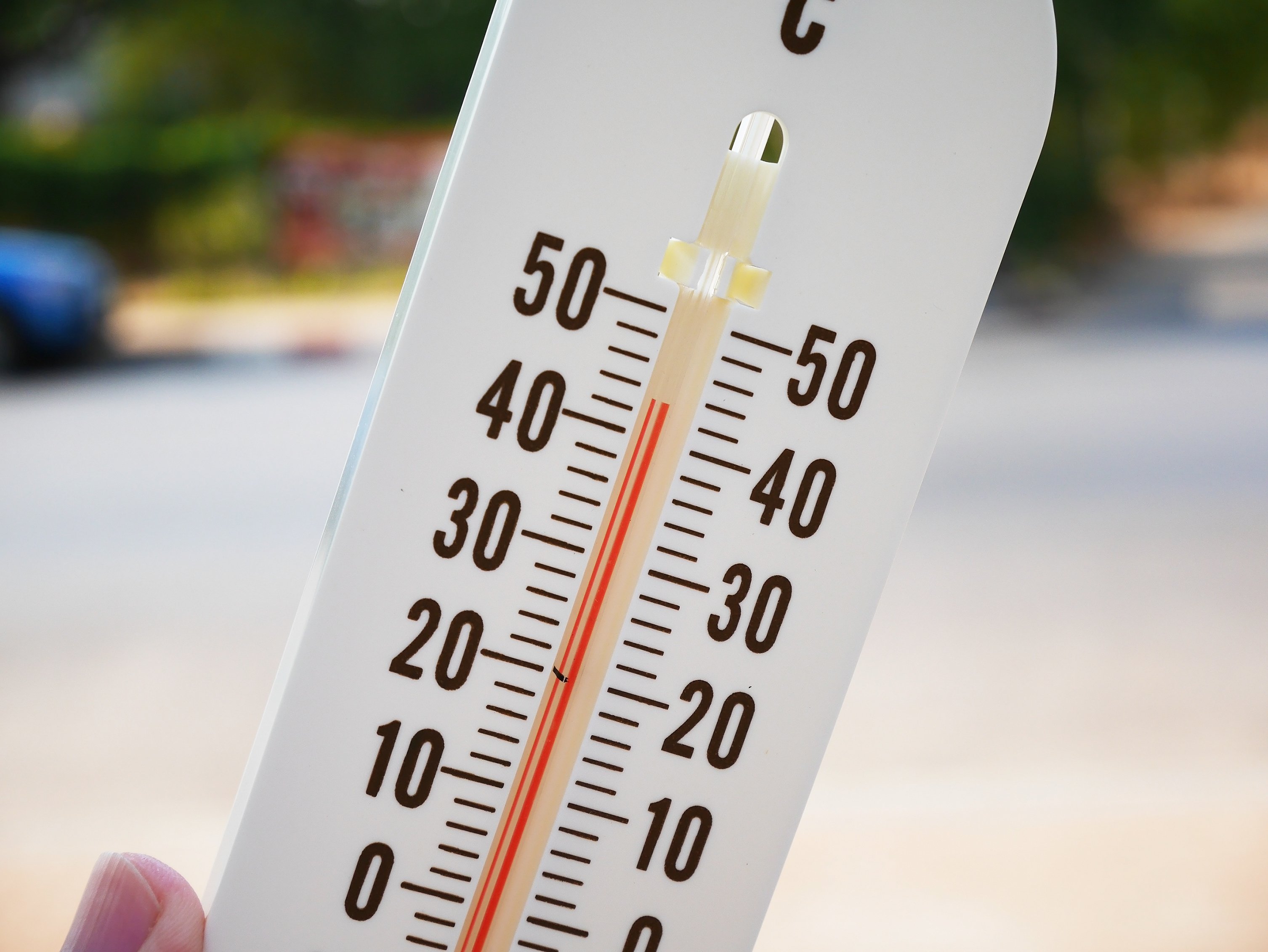 hand hold thermometer showing temperature in degrees Celsius, Hot temperature