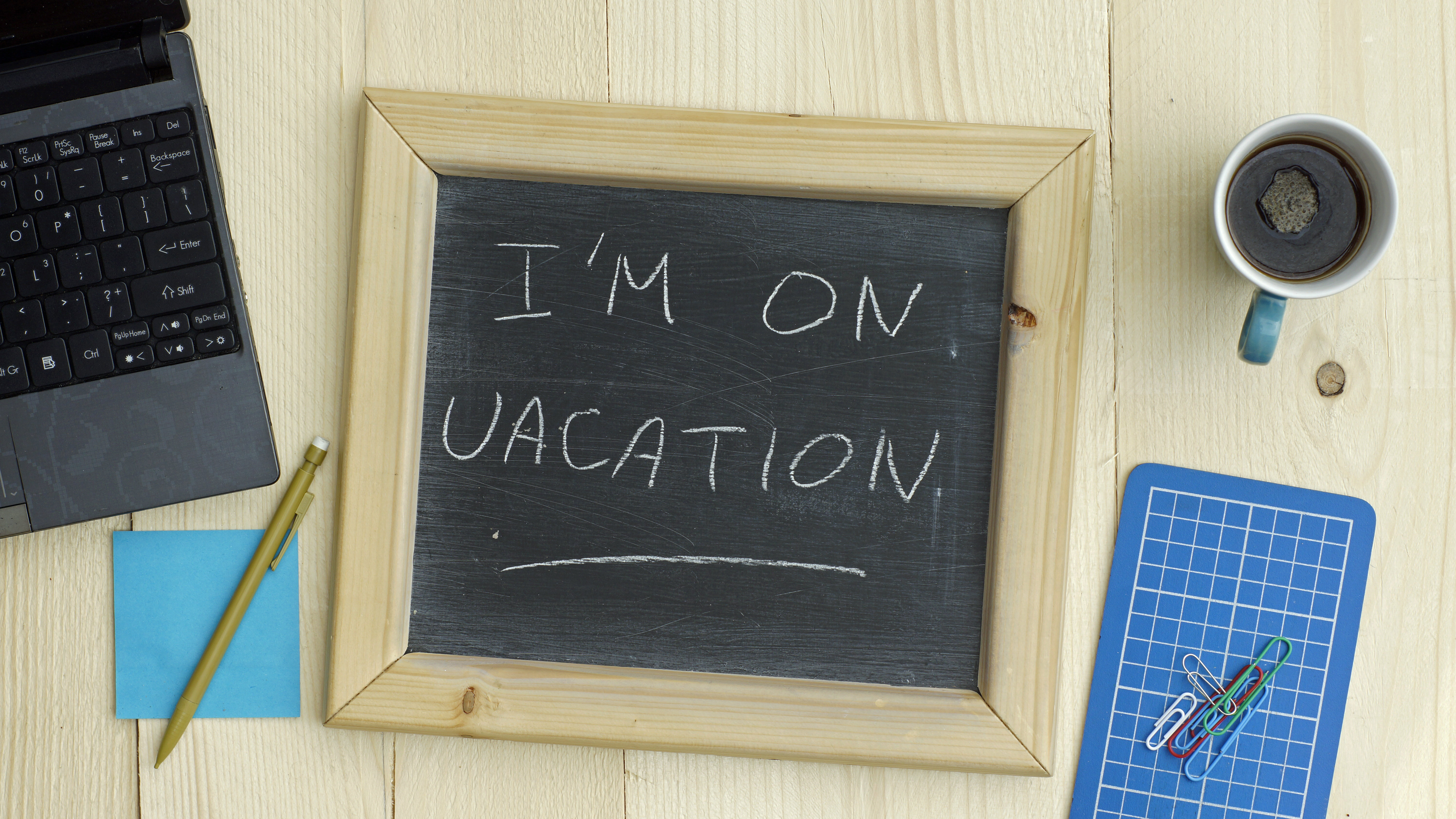 I'm on vacation written on a chalkboard at the office