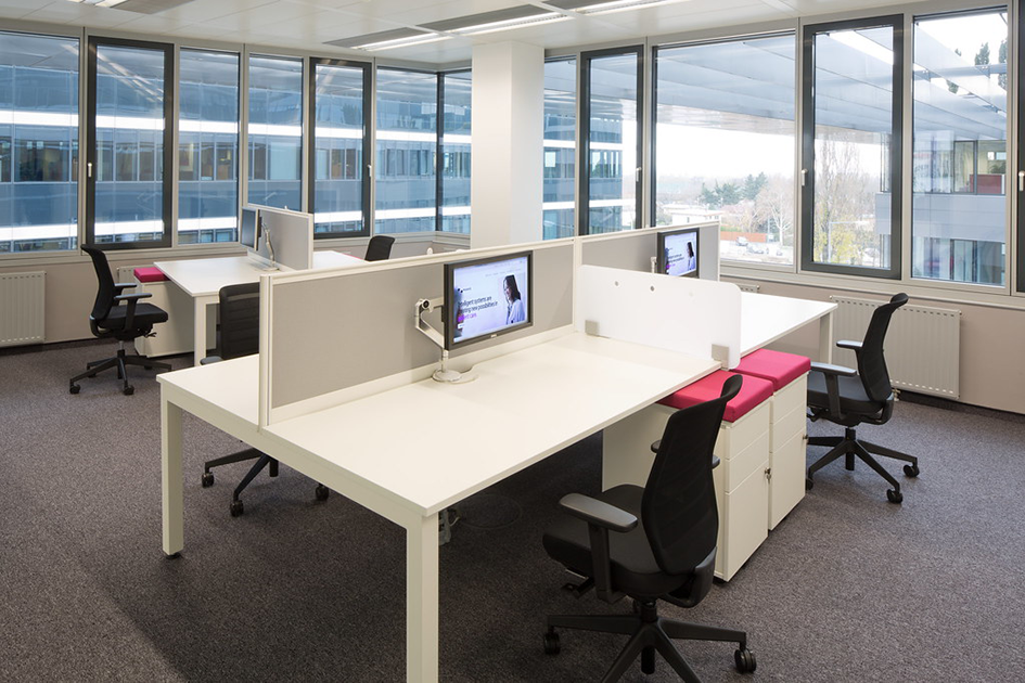 open concept office with multiple work stations
