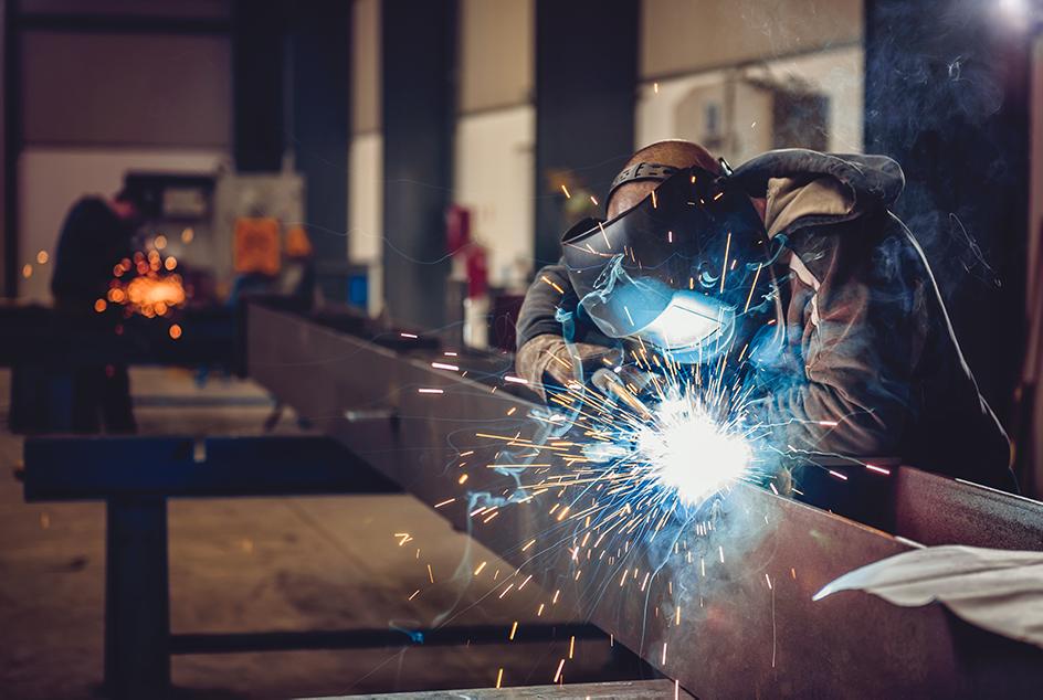 Worker welding pipe