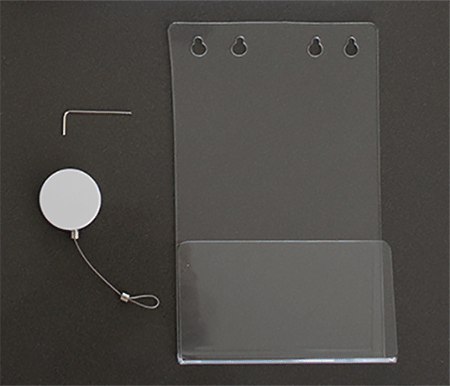 Green Book Holder (clear plastic), Allen key and retractable cord laid out on table
