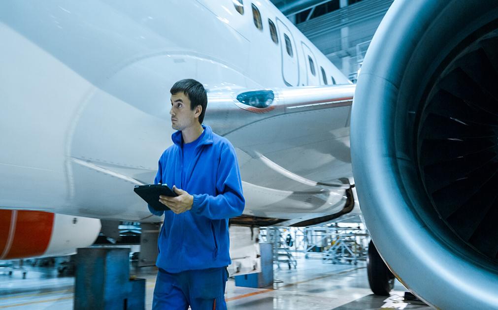 Worker near airplane engine
