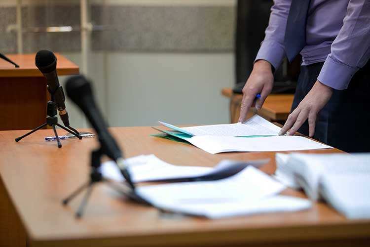 Table in courtroom with microphones