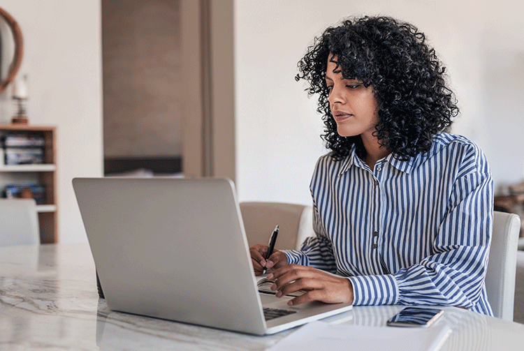 Woman working on a laptop at home