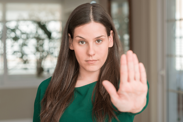 Woman holding her hand up to signal stop